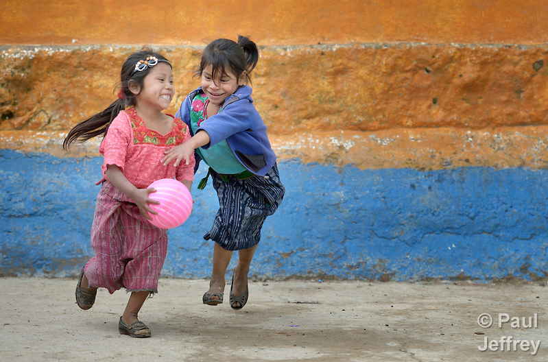Girls play basketball during a recess from school in Tuixcajchis, a small Mam-speaking Maya village in Comitancillo, Guatemala. (Paul Jeffrey)