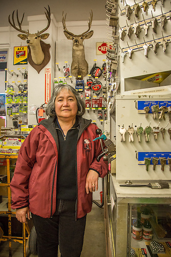 """I've worked here for 17 years.  I live in Windsor...and could work closer to home...but I continue to work here...I will probably retire here.""  -Hardware sales associate Maria Rivera prepares to copy a key at the ACE Hardware store in downtown Calistoga. (Clark James Mishler)"