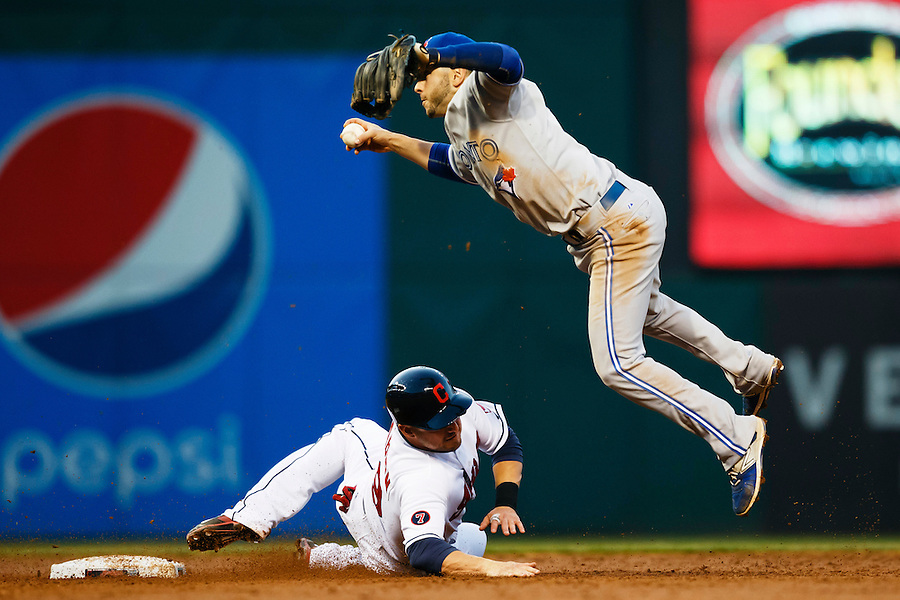 May 1, 2015; Cleveland, OH, USA; Toronto Blue Jays shortstop Jonathan Diaz (1) leaps over a sliding Cleveland Indians designated hitter Ryan Raburn (9) in the third inning at Progressive Field. Mandatory Credit: Rick Osentoski-USA TODAY Sports (Rick Osentoski/Rick Osentoski-USA TODAY Sports)