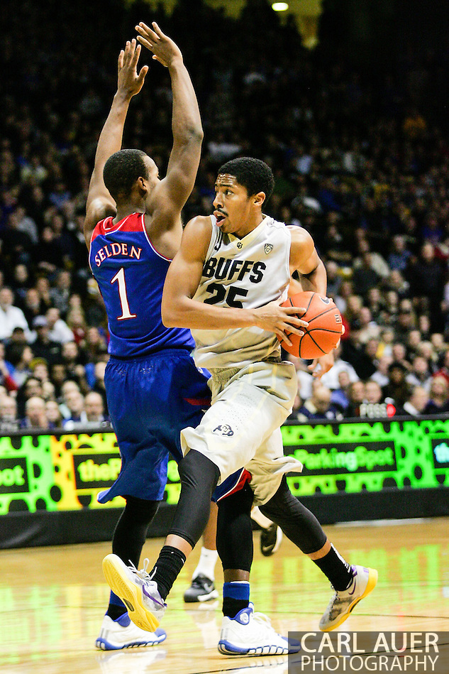 December 7th, 2013:  Colorado Buffaloes junior guard Spencer Dinwiddie (25) makes a move towards the basket past Kansas Jayhawks freshman guard Wayne Selden, Jr. (1) in the second half of the NCAA Basketball game between the Kansas Jayhawks and the University of Colorado Buffaloes at the Coors Events Center in Boulder, Colorado (Carl Auer/ZUMAPRESS.com)