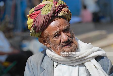 TAIZZ, YEMEN - SEPTEMBER 16, 2006: Portrait of unidentified man in a turban at the street in Taizz, Yemen. Senior men in Yemen cover hair and beard with henna to hide grey hair. (Dmitry Chulov)