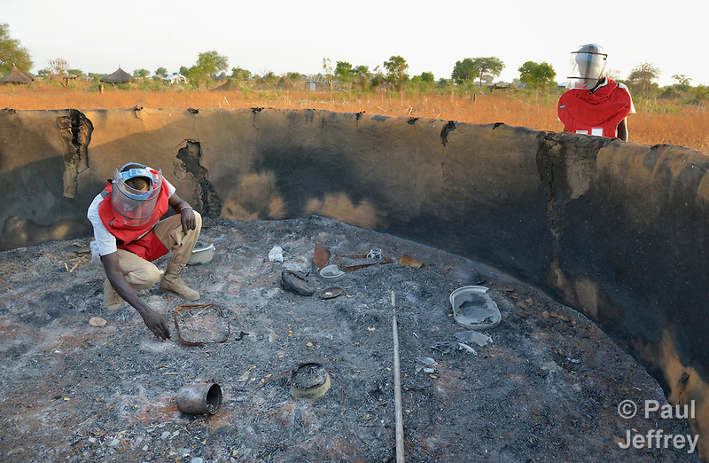 Members of an ACT Alliance team search for unexploded ordnance in the charred remains of a house near the South Sudan town of Bor, which has been the scene of heavy fighting between government troops and rebels since a dispute within the ruling party turned violent in December 2013 and quickly ripped the newly independent nation along ethnic and tribal lines. The explosive ordnance disposal team is part of the humanitarian mine action program of Dan Church Aid, a member of the ACT Alliance. The program also deploys mine risk education teams to help villagers identify and understand the dangers of unexploded ordnance and land mines from this most recent conflict as well as ordnance left over from decades of civil war. (Paul Jeffrey)