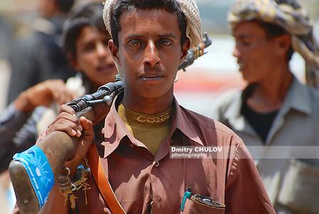 ADEN, YEMEN - SEPTEMBER 14, 2006: Unidentofied young Yemeni man holds a rifle in Aden, Yemen. (Dmitry Chulov)