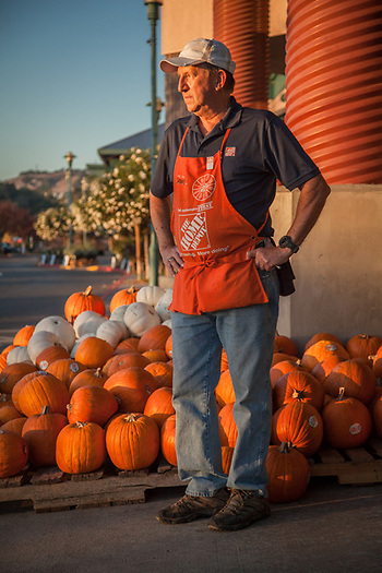 "Landscape Associate, David Rabon, looks for customers who may need assistance at the Home Depot in Santa Rosa, CA  ""I am retired military and a retired accountant...I work here part time and love it.""  dlrabon@aol.com (© Clark James Mishler)"