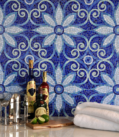 Natasha, a hand cut jewel glass mosaic is shown in Iolite, Lapis Lazuli, Blue Spinel, Covellite, and Feldspar, is part of the Delft Collection by Sara Baldwin for New Ravenna Mosaics. (Picasa)