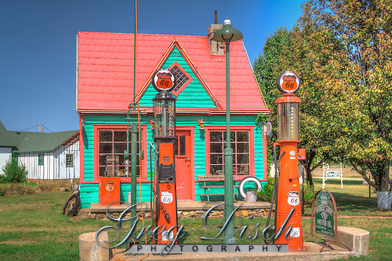 "The Phillips 66 service station was located on old Route 66 near the turn off to Red Oak Missouri. The station was brought to Red Oak II and completly restored inside and out in 1989. Red Oak II is the creation of artist Lowell Davis, who's family had pioneered the town of Red Oak. After success as an artist, he started moving his old home town to his farm 32 miles away creating Red Oak II. Lowell now lives in what he considers his ""Masterpiece"" in the Belle Starr house where the famous outlaw was raised. Red Oak II is located a few miles Northeast of Carthage Missouri, just off Route 66. (Greg Disch gdisch@gregdisch.com)"