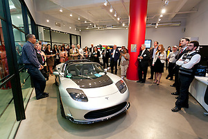 Michael Sexton, Tesla Motors addresses guests at the MCC Transportation Transformation Series: Opening Reception at Tesla Showroom held  May 11, 2011 at Tesla Motors New York, 511 West 25th Street, New York. This exciting series was presented by MCC's Green Business Committee, MCC's Tech and Innovation Committee and E3NYC. The MCC offers the business community a variety of perspectives of the direction of clean transportation in New York and beyond. The Tesla Roadster is the world's only automobile that offers supercar performance without supercar emissions. Engineered for performance and efficiency, it accelerates from 0 to 60 in 3.7 seconds, delivering 295 lbs-ft. of torque without using a drop of gasoline. The Roadster travels 245 miles on a single charge and plugs into nearly any outlet in the world - allowing for uncompromised electric driving. The event was sponsored by Con Edison Commercial & Industrial Energy Efficiency Programs for sponsoring the MCC Green Business Committee for 2011. (Jeffrey Holmes/JeffreyHolmes.com)
