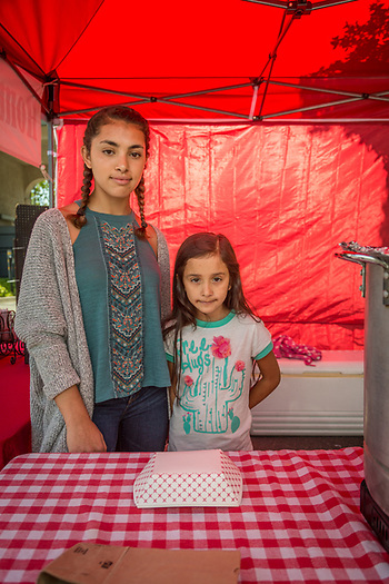 """I've been working helping at this booth for 13 years.""  -Sixteen year old Citlalli Garcia sells home made Tamales with help from her seven year old cousin, Sofia, at the Calistoga Saturday Market (Clark James Mishler)"