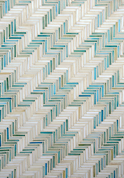 Houndstooth, a hand cut jewel glass mosaic shown in Aquamarine and Quartz, is part of the Houndstooth Collection by Sara Baldwin for New Ravenna Mosaics. (New Ravenna ®)