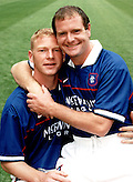 1997 RANGERS TEAM PHOTO-SHOOT AT IBROX STADIUM, PAUL GASCOIGNE CUDDLES UP TO JORG ALBERTZ, ROB CASEY PHOTOGRAPHY. (ROB CASEY/ROB CASEY PHOTOGRAPHY)
