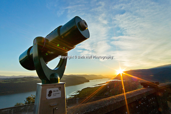A coin operated telescope is seen at sunrise at the The Vista House that overlooks the Columbia River Gorge in Corbett, Oregon. (Beth Hall)