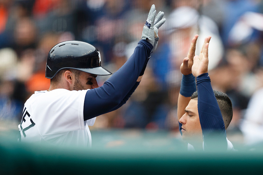 Apr 6, 2015; Detroit, MI, USA; Detroit Tigers left fielder J.D. Martinez (28) receives congratulations from shortstop Jose Iglesias (1) after he hits a home run in the second inning against the Minnesota Twins at Comerica Park. Mandatory Credit: Rick Osentoski-USA TODAY Sports (Rick Osentoski/Rick Osentoski-USA TODAY Sports)