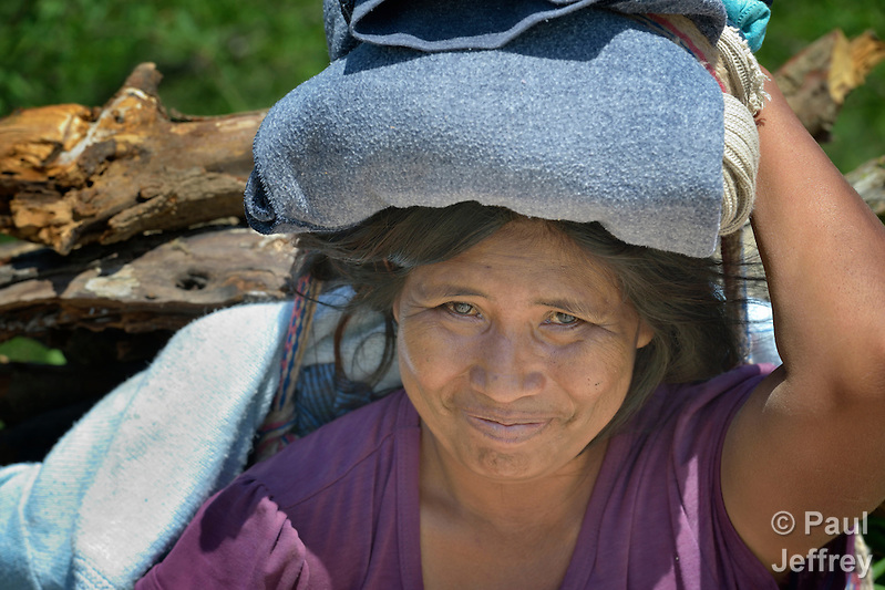 A Wichi indigenous woman carries firewood in Santa Victoria Este, a town in the Chaco region in northern Argentina. The Wichi, who traditionally survived as hunter-gatherers, have struggled against the systematic expropriation of their land for over a century by mestizo cattleraisers who migrated into the region from elsewhere in Argentina. In 2014, the two groups finally agreed on a division of the land which recognizes the traditional land rights of the indigenous, and which resettles many mestizo families onto non-indigenous land. Church World Service has worked as a partner with local residents as they negotiated the landmark settlement. (Paul Jeffrey)