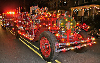 Night photography, Antique fire engine in Cape May Christmas parade decorated with holiday lights (Blair Seitz)