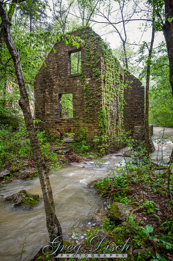 The remains of Mitchell Mill on North Sylamore Creek and water running over the dam at Mirror Lake at the Blanchard Springs Recreation Area in the Ozark National Forest in Arkansas. Steve Mitchell built his mill on the location of the Mill built by John Blanchard in 1880's. The dam and part of the mill were restored in the 1940's by the CCC but was never completed. (Greg Disch gdisch@gregdisch.com)