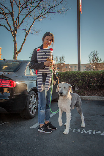 "Yijing with her sheepdog, Bob, outside the Pet Food Express store in Pleasant Hill, CA. ""I bought this for Bob...he really wanted it."" (© Clark James Mishler)"