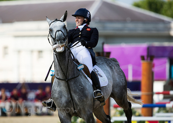 12 AUG 2012 - LONDON, GBR - Mhairi Spence (GBR) of Great Britain struggles to control her horse Coronado's Son after clearing a fence during the women's London 2012 Olympic Games Modern Pentathlon riding in Greenwich Park, Greenwich, London, Great Britain .(PHOTO (C) 2012 NIGEL FARROW) (NIGEL FARROW/(C) 2012 NIGEL FARROW)