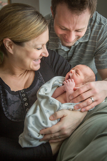 Sarah and David Jefferies with three day old Avalyn at their home in Anchorage (© Clark James Mishler)