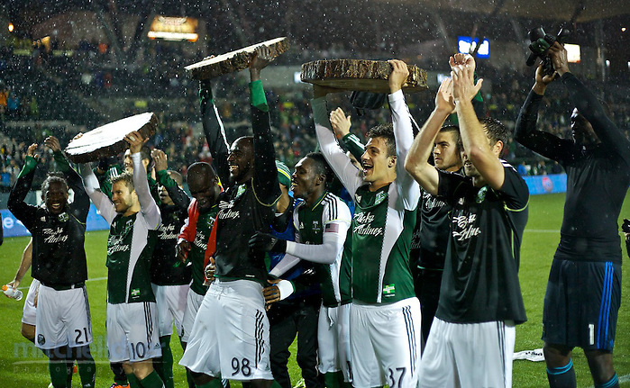 May 3, 2014; Portland, OR, USA; The Timbers hold up log slabs after the 3-2 win at Providence Park. Photo: Craig Mitchelldyer-Portland Timbers (Craig Mitchelldyer)