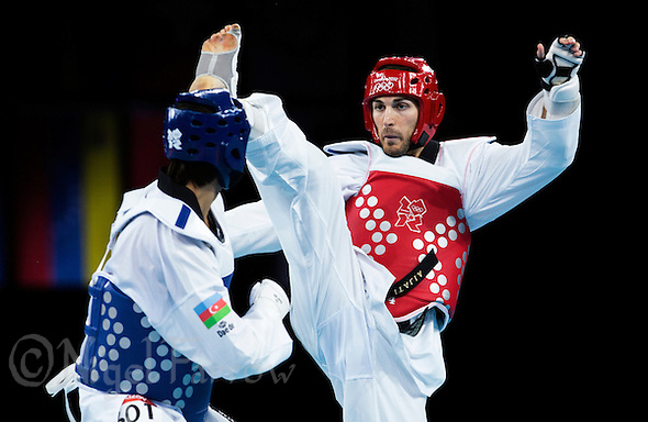 10 AUG 2012 - LONDON, GBR - Mauro Sarmiento (ITA) (right) of Italy aims a kick at Ramin Azizov of Azerbaijan during their men's -80kg category quarter final contest at the London 2012 Olympic Games Taekwondo at Excel in London, Great Britain .(PHOTO (C) 2012 NIGEL FARROW) (NIGEL FARROW/(C) 2012 NIGEL FARROW)