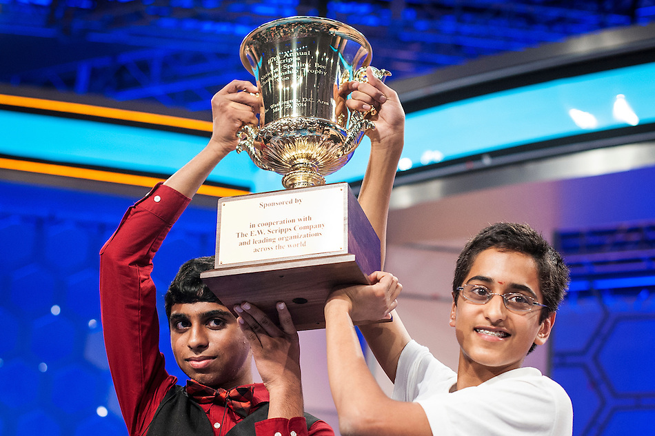 Co-champions Ansun Sujoe, 13, of Fort Worth, Texas, and Sriram Hathwar, 14, of Painted Post, New York, hoist the trophy after winning the Scripps National Spelling Bee on May 29, 2014 at the Gaylord National Resort and Convention Center in National Harbor, Maryland. (Pete Marovich/UPI)