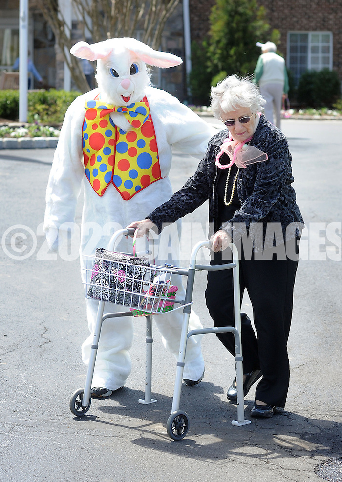 SOUTHAMPTON, PA - APRIL 17:  The Easter Bunny accompanies Lucille Deigendesch during an Easter Egg hunt for residents at Southampton Estates April 17, 2014 in Southampton, Pennsylvania. (Photo by William Thomas Cain/Cain Images) (William Thomas Cain)
