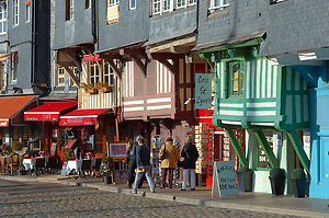 Harbour side restauarants and shops. Honfleur, Normandy, France. (By Travel photographer Paul Williams. http://funkystockstockphotos.com)