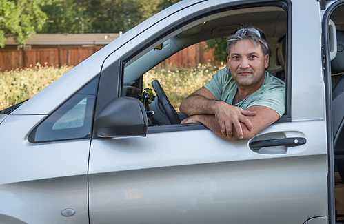 """I've always wanted to work for myself...I bought this van February and started a wine tour company...business is great.""  -Alan Colaso sits in his Mercedes on Myrtle Street in Calistoga. (Clark James Mishler)"