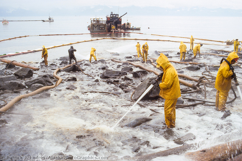 Exxon Valdez Oil Spill Clean up crews use hot water hoses to wash oil from Point Helen, Knight Island, August 1989, Prince William Sound, Alaska (Patrick J. Endres / AlaskaPhotoGraphics.com)