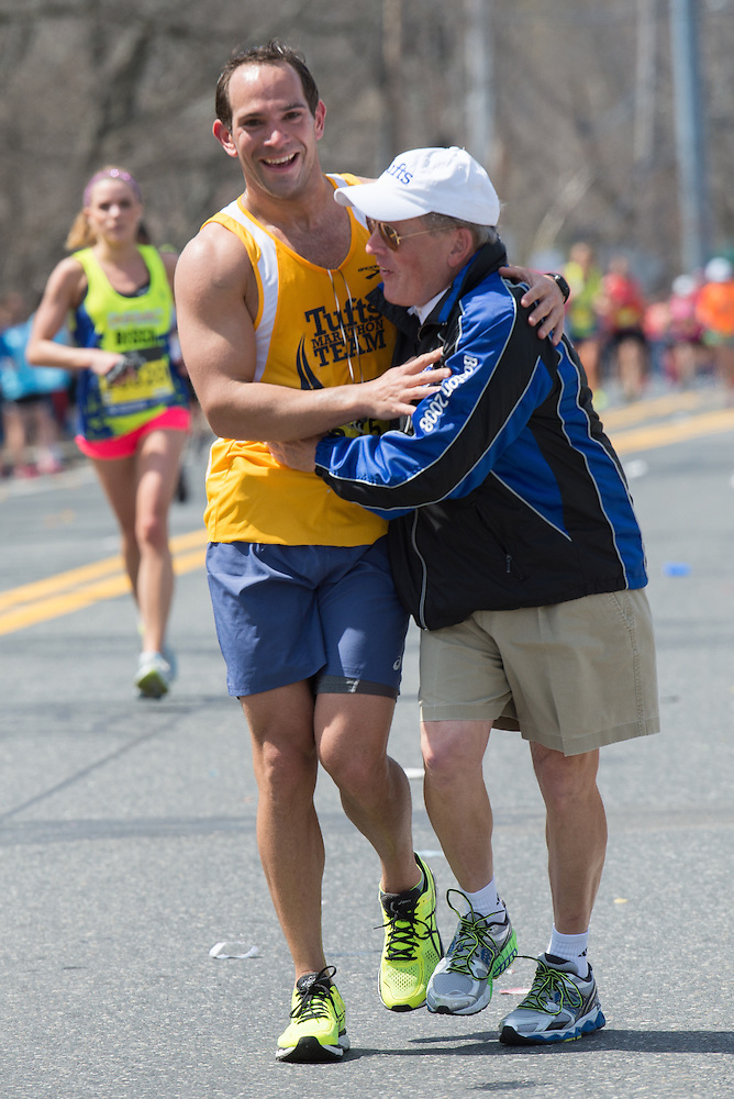4/18/16 – Natick, MA – Tufts Marathon Team runner Kyle Backstrom and Tufts Marathon Team coach Donald Megerle embrace at Mile 9 of the 2016 Boston Marathon in Natick, MA on April. 18, 2016. (Sofie Hecht / The Tufts Daily) (Sofie Hecht / The Tufts Daily)