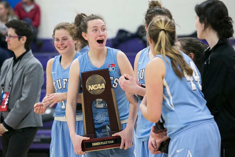 03/22/2014- Stevens Point, Wisc. - Tufts guard Liz Moynihan, A14, jokes around with teammates with the NCAA fourth-place trophy after their 72-54 loss to Wisconsin-Whitewater in the NCAA Division III Women's Final Four consolation game at Quandt Fieldhouse on Mar. 22, 2014. (Kelvin Ma/Tufts University) (Kelvin Ma/Tufts University)