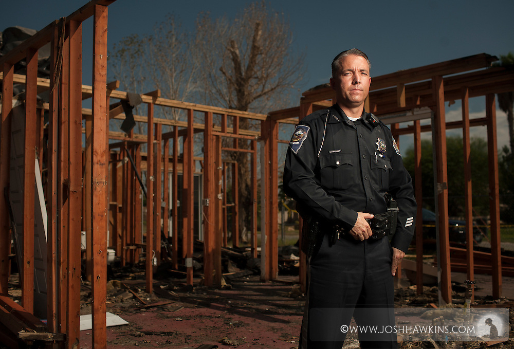 While on patrol, Nevada State Trooper Robert Borchardt saw smoke rising from a nearby home.  The fire quickly spread while he barely had time to save four teenagers from the burning home. (Josh Hawkins)