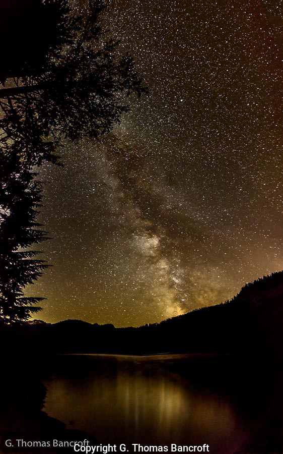 The Milky Way was bright over Lake Dorothy.  I found a rock ledge to squeeze out onto the lake so I could have a full view from the horizon to right over my head. (G. Thomas Bancroft)