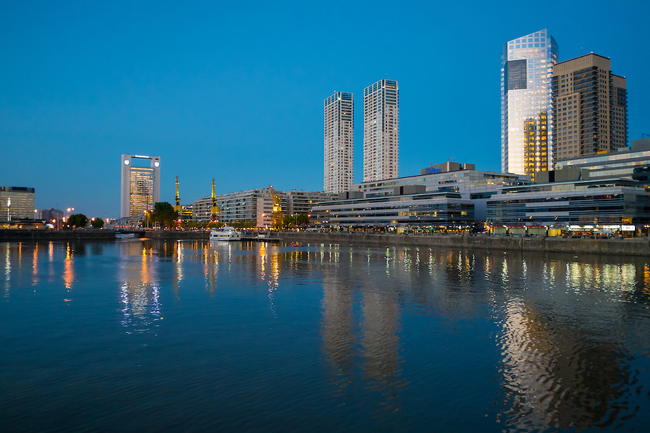 BUENOS AIRES - CIRCA NOVEMBER 2012: Skyline in the neighborhood of Puerto Madero at night, circa November 2012. This is a popular tourist destination with over 2.5 million yearly visitors . (Daniel Korzeniewski)