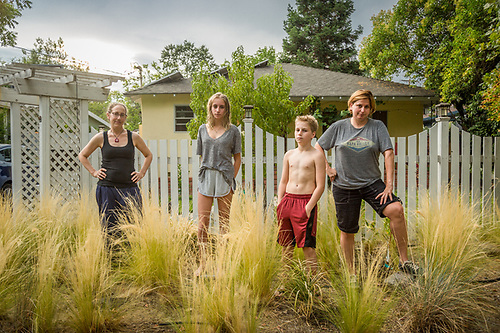 """My mother divorced my dad and married Bobbi...so Bobbi is now our 'bonus mom'...it's all kind of mess but, somehow, it seems to be working.""   -Fifteen year old Lucy Moore with Bobbie Frioli,  Johah Moore, and Jennifer Press stand in front of their home in Calistoga. (Clark James Mishler)"