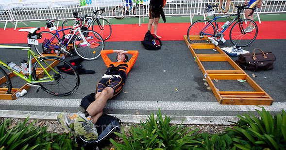 18 SEP 2011 - LA BAULE, FRA - A competitor from TC Nantais  recovers after the Triathlon Courte Distance (Olympic or standard distance) at the 24th Triathlon Audencia in La Baule, France .(PHOTO (C) NIGEL FARROW) (NIGEL FARROW/(C) 2011 NIGEL FARROW)
