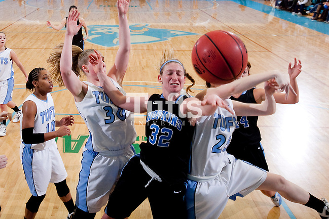 03/03/2012 - Medford, Mass. - Johns Hopkins guard Chantel Mattiola gets her shot blocked by Tufts guard Liz Moynihan, A14, right, in Tufts' 55-46 win over Johns Hopkins in the second round of the NCAA Division III Women's Basketball Championship at Tufts University's Cousens Gymnasium on March 3, 2012. (Kelvin Ma/Tufts University)
