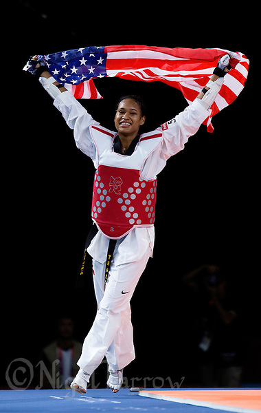10 AUG 2012 - LONDON, GBR - Paige McPherson (USA) of the USA celebrates winning her women's -67kg category bronze medal A contest against Franka Anic of Slovenia during the London 2012 Olympic Games Taekwondo at Excel in London, Great Britain .(PHOTO (C) 2012 NIGEL FARROW) (NIGEL FARROW/(C) 2012 NIGEL FARROW)
