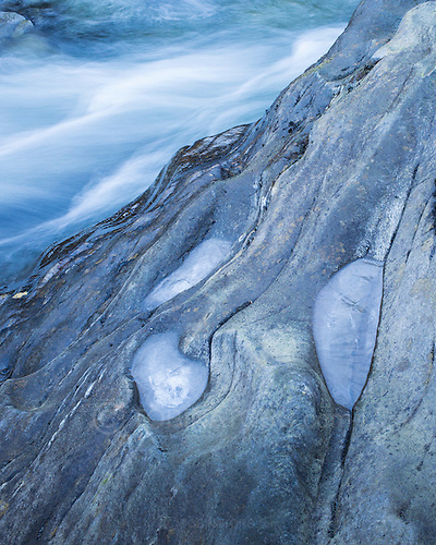 Small pools of water are frozen near a waterfall in Scotland. (Andrew Tobin)