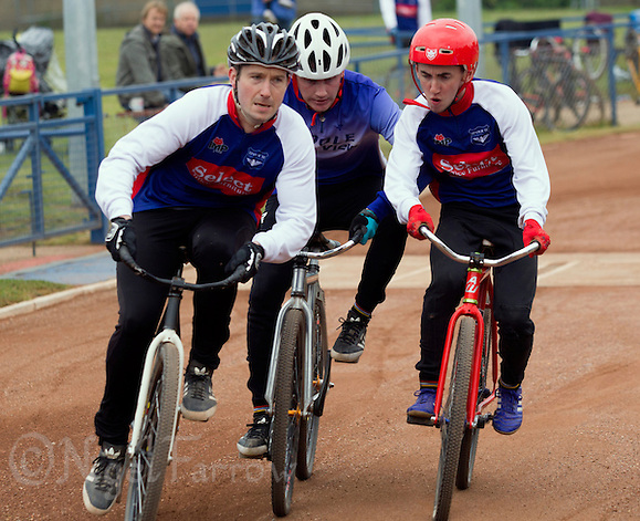 14 JUN 2015 - IPSWICH, GBR - Matt Hill (right) of Ipswich Eagles holds off Dean Hook (centre) of Poole Comets as Adam Peck (left) also of Ipswich Eagles squeezes past into second place during their Elite League cycle speedway fixture at Whitton Sports and Community Centre in Ipswich, Suffolk, Great Britain (PHOTO COPYRIGHT © 2015 NIGEL FARROW, ALL RIGHTS RESERVED) (NIGEL FARROW/COPYRIGHT © 2015 NIGEL FARROW : www.nigelfarrow.com)