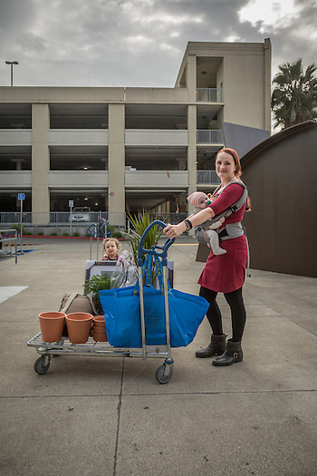 """I would like to open an environmentally friendly kid's boutique.""   -Cassandra Frantz with her daughters, Vaughn and Noemi,  outside the IKEA in Emeryville, CA (Clark James Mishler)"