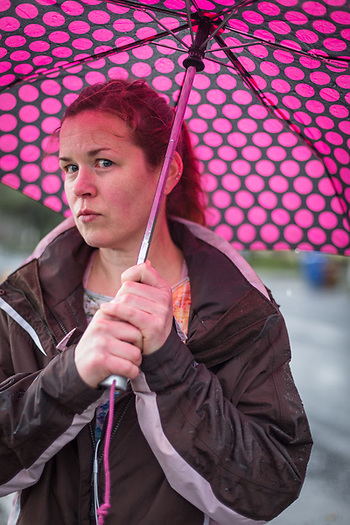 """""""I love to walk in the rain. No matter the weather, I try to get out every day. With full time work and two kids, it's not always easy."""" -Chenoa Olson walks on Grant Street on a rainy day in Calistoga. (Clark James Mishler)"""