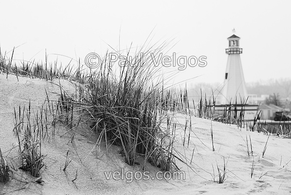 Photo of New Buffalo Michigan lighthouse and beach grass. New Buffalo is a popular beach community in Southwest Michigan in the United States. (Paul Velgos)