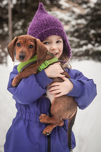 Four year old Adelin with her new puppy, Chewey, Anchorage (Clark James Mishler)