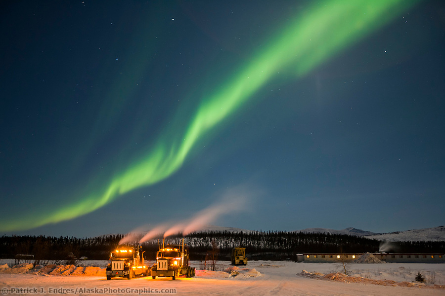 Trucking photos: Aurora streams over Semi tractor trailer trucks at the Coldfoot truckstop in Coldfoot, Alaska. (Patrick J. Endres / AlaskaPhotoGraphics.com)