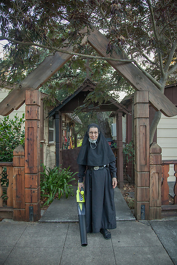 Sister Pearl prepares to clear leaves in front of her home at the Holy Assumption Monastery on Washington Street in Calistoga. (Clark James Mishler)