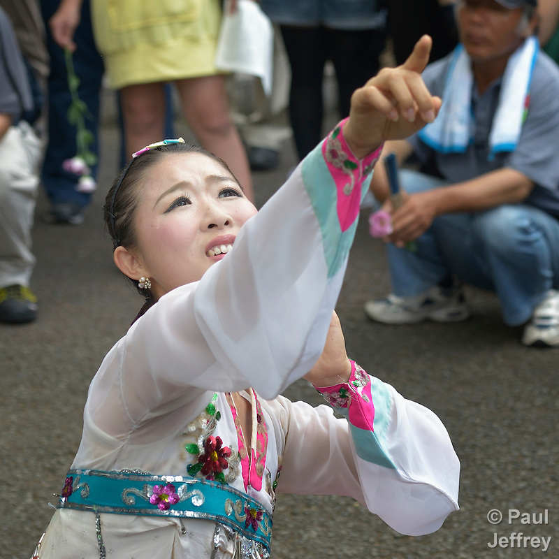 Kim Myosu, a Korean-Japanese dancer, points to horror coming from the sky as she performs during a ceremony in Nagasaki, Japan, on August 9, 2015, commemorating the 70th anniversary of the killing of Korean forced laborers when the United States dropped an atomic bomb on the city. The Koreans had been brought to Japan to work as slaves during the war. The church in Japan has played a key role in addressing Japan's complicity in violence and murder during the war years. The ceremony included the participation of a delegation of pilgrims from the World Council of Churches who each came to Japan to see for themselves the results of the bombings 70 years ago, to listen to survivors and local church leaders, and to recommit themselves to new forms of advocacy for a world free of nuclear weapons. (Paul Jeffrey)