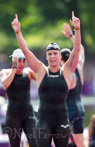 09 AUG 2012 - LONDON, GBR - Eva Risztov (HUN) of Hungary celebrates winning the London 2012 Olympic Games women's 10km Marathon Swimming in Hyde Park, London, Great Britain .(PHOTO (C) 2012 NIGEL FARROW) (NIGEL FARROW/(C) 2012 NIGEL FARROW)