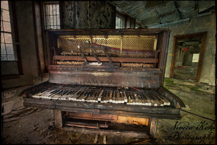 Piano in an abandoned mental asylum (Viveca Koh)