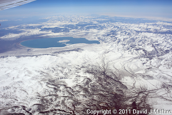 Aerial View of Mono Lake from 36,000 feet and 27 miles during a commercial flight from San Francisco to Newark. Image acquired with a Leica X1 (ISO 100, 24 mm, f/6.3, 1/1000 sec). Processed: Capture One 6 Pro (raw conversion, haze reduction), Photoshop CS5, Focus Magic (sharpening), Nik Define 2 (noise reduction), Photoshop CS5 (save for web). (David J Mathre)